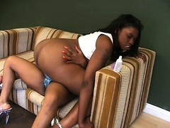 Filthy ebony lesbians make each other cum with a big strap-on