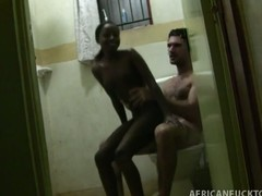 This voyeur-esque scene features Antonio picking up the latest in a long string of African amateur beauties. He is lucky enough to go on business trips and explore the breadth of gorgeous amateurs on this continent. Tiny starts off by massaging him down and then she sits down on the toilet to start sucking his dick. She has no idea that a camera is right by the door of the bathroom, and she ends up getting cum all over her face, with the camera switching over to POV to capture that Kodak moment.